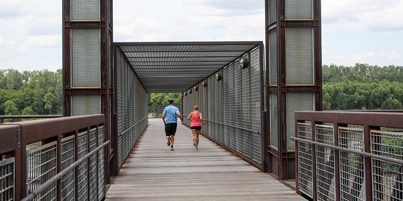 Two runners on the Town of Kansas Bridge